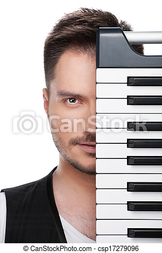 Portrait of young adult musician with half face covered with piano keyboard.  Standing isolated over white background  - csp17279096