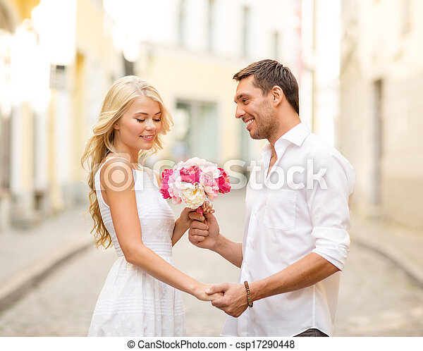 couple with flowers in the city - csp17290448