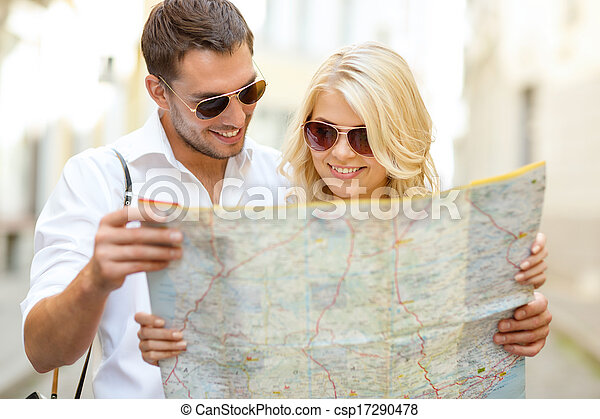 smiling couple in sunglasses with map in the city - csp17290478