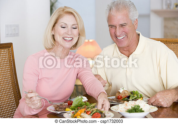Elderly Couple Enjoying Healthy meal, mealtime Together - csp1732003