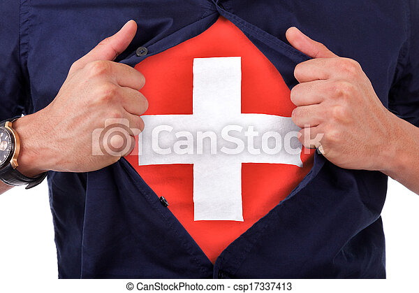 Young sport fan opening his shirt and showing the flag his country switzerland, swiss flag - csp17337413
