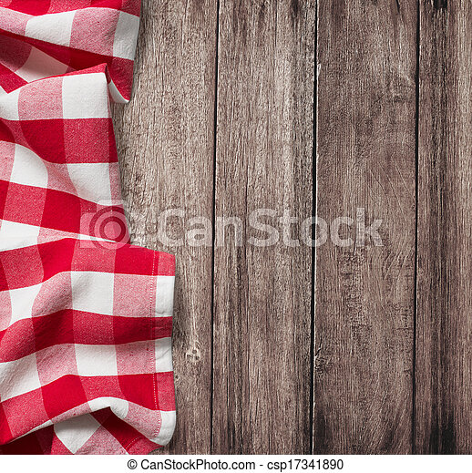 old wooden table with red picnic tablecloth and copyspace  - csp17341890