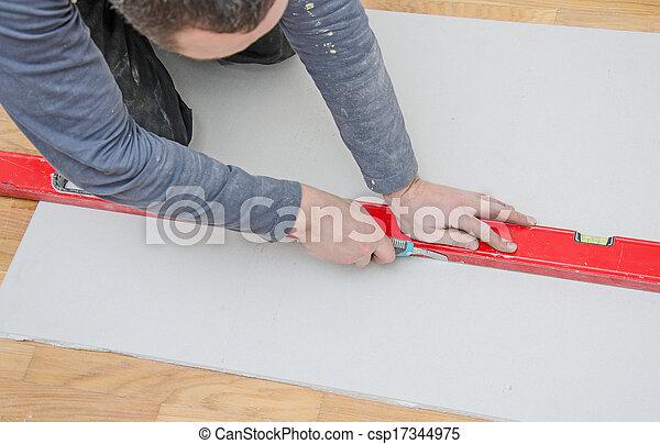 bilder von mann messen schneiden gips gipskarton csp17344975 suchen sie stock fotografie. Black Bedroom Furniture Sets. Home Design Ideas