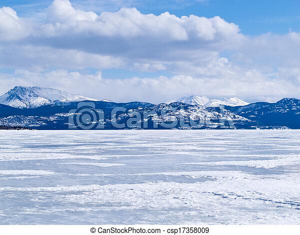 Frozen Lake Laberge winter landscape Yukon Canada - csp17358009