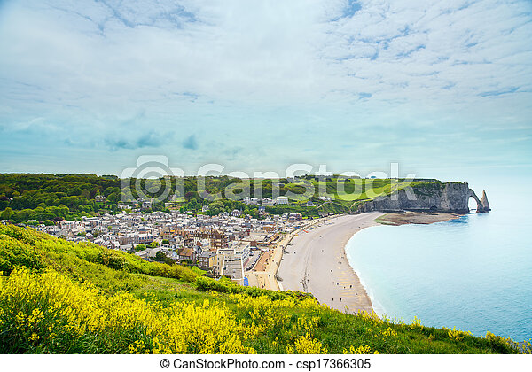 Etretat village, beach and Aval cliff landmark on ocean. Aerial view. Normandy, France, Europe. - csp17366305