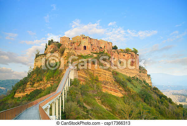 Civita di Bagnoregio landmark, bridge view on sunset. Italy - csp17366313