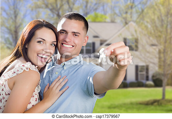 Military Couple with House Keys In Front of New Home - csp17379567