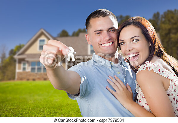 Military Couple with House Keys In Front of New Home - csp17379584
