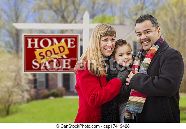Family in Front of Sold Real Estate Sign and House - csp17413428