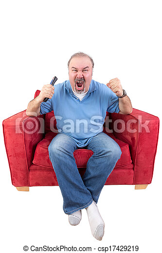 Man screaming at the television - csp17429219