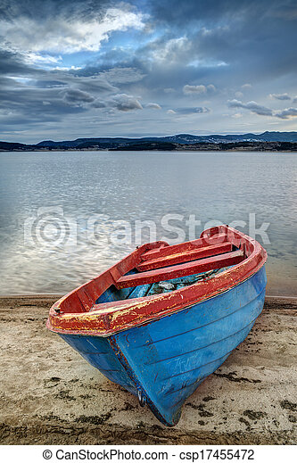 Boat on a lake in the mountains - csp17455472