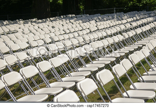 White plastic chairs set for an outdoor event