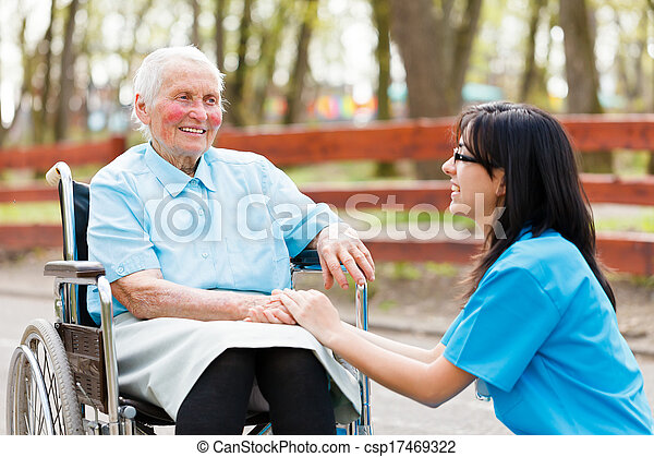 Chatting with Elderly Lady - csp17469322