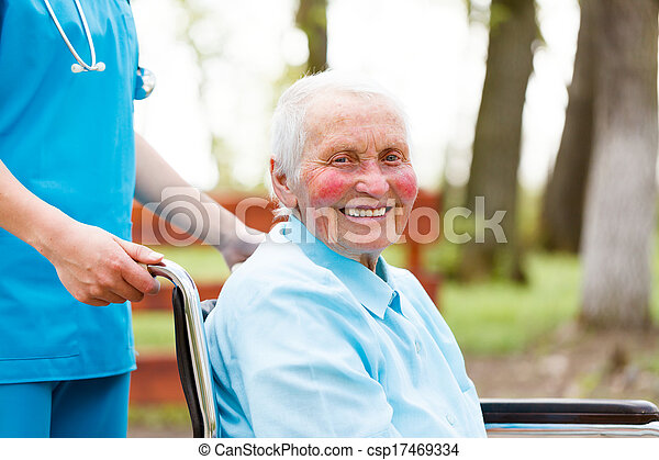 Smiling Elderly Lady in Wheelchair - csp17469334