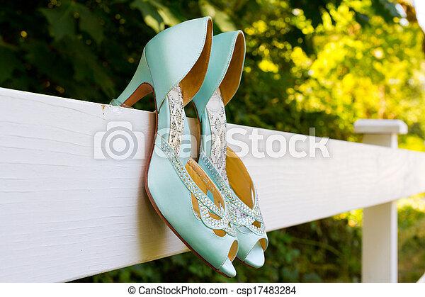 Blue Wedding Shoes on Fence