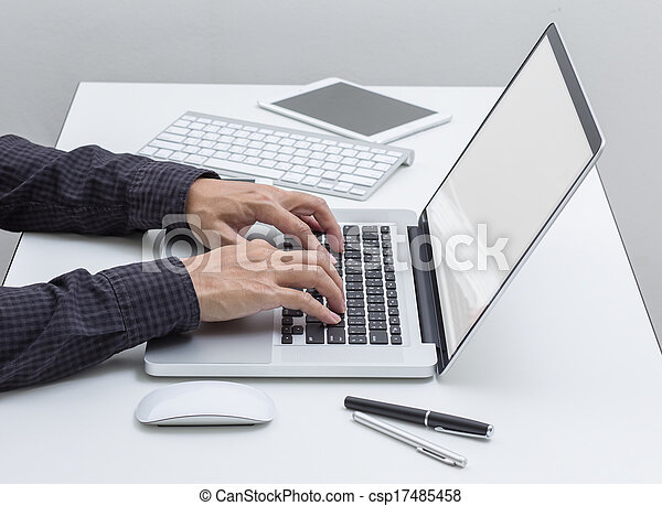 Man hands working on laptop computer - csp17485458