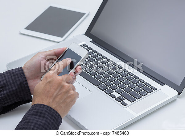 Man hand working with smartphone with computer background. Technology.  - csp17485460