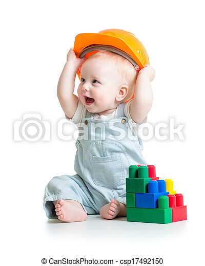 kid playing with building blocks toy - csp17492150