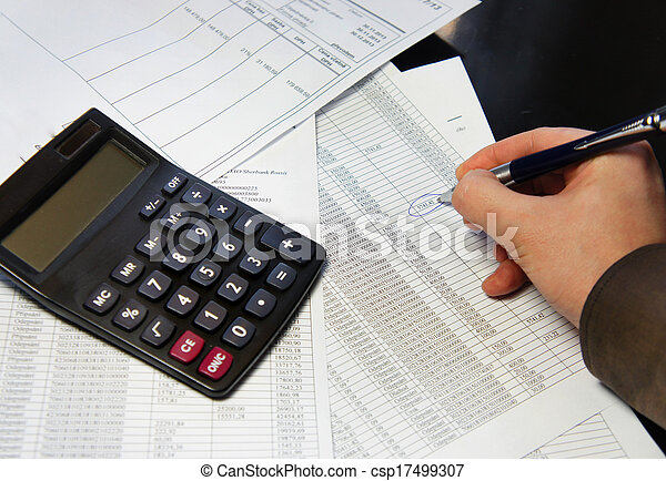 Office table with calculator, pen and accounting document - csp17499307