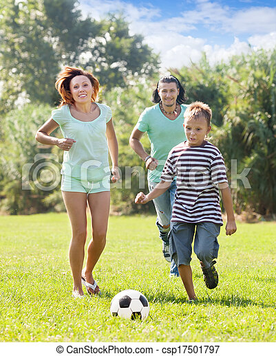 Family of three playing in soccer