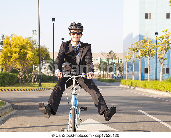 businessman riding bicycle to office for eco-friendly - csp17525120