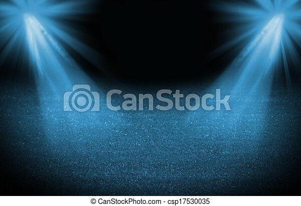 Blue cold light soccer field, bright spotlights, illuminated stadium