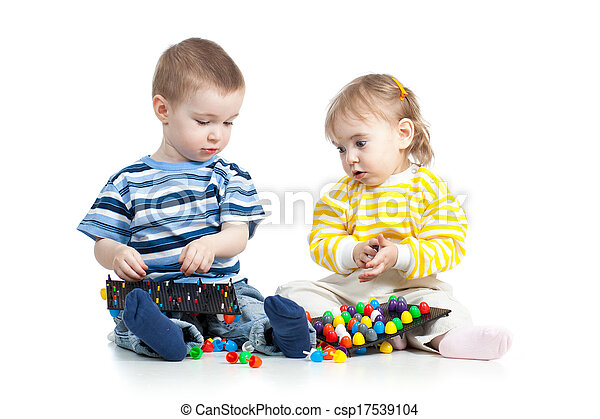 children play with mosaic toy - csp17539104