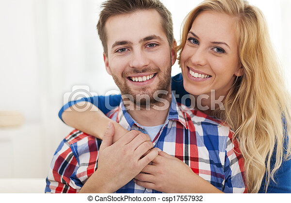 Close up happy embraced couple - csp17557932