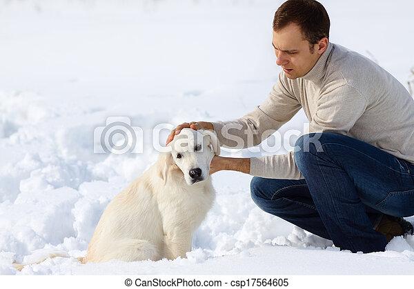 Winter Labrador retriever with owner