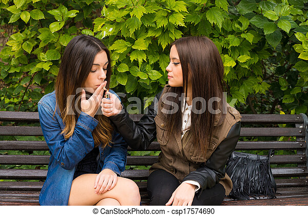 Photo - Girls smoking on a bench - stock image, images, royalty free ...