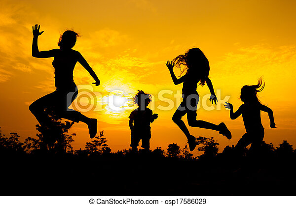 Happy  family dancing on the  road in the  sunset time. - csp17586029