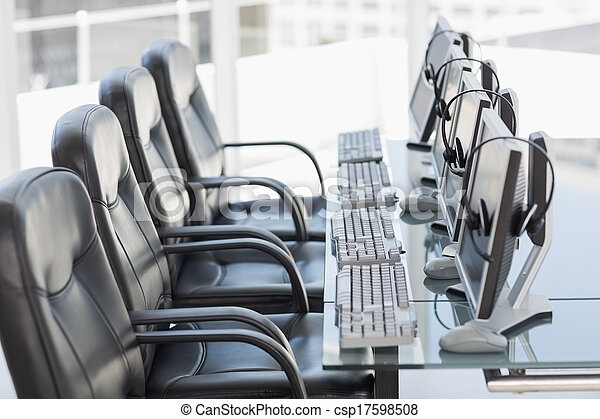 Chairs, computers and headset in a modern office - csp17598508