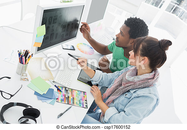 Two artists working on computer at the office - csp17600152