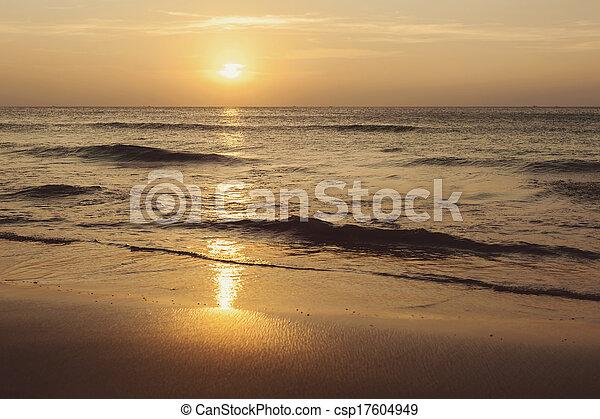 Tropical beach at beautiful sunset - csp17604949
