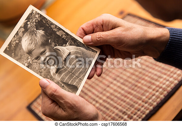 close up from a man with old photo - csp17606568