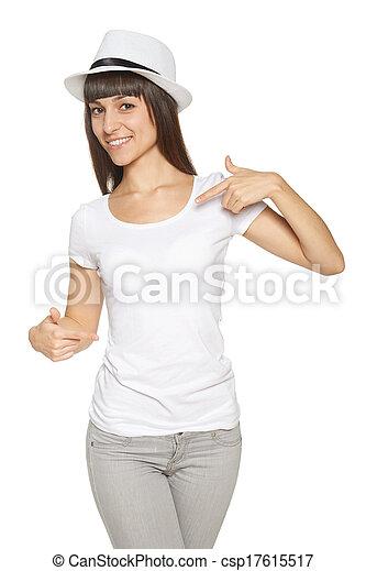 Smiling woman pointing at blank white t-shirt - csp17615517