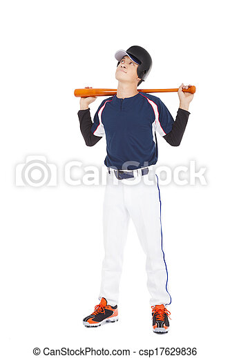 Young adult baseball player holding bat and thinking - csp17629836