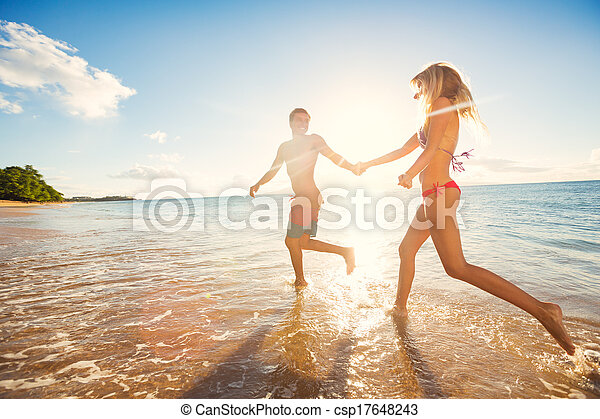 Happy Couple on Tropical Beach at Sunset - csp17648243
