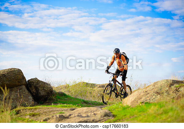 Cyclist Riding the Bike on the Beautiful Mountain Trail - csp17660183