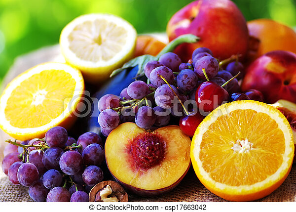 Slices of peach, grapes and citrus fruits