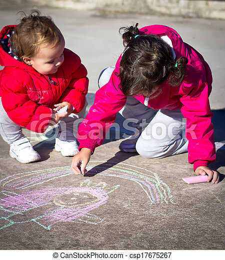 little girls painting with chalk