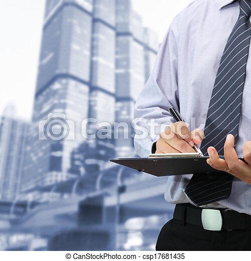 Businessman signing a document  - csp17681435