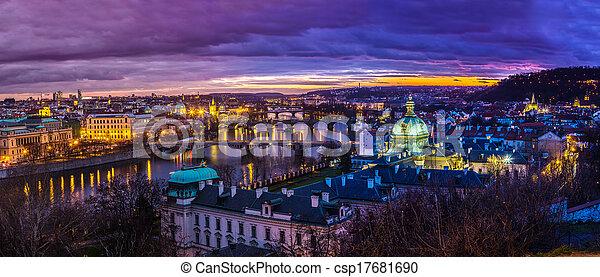 Bridges in Prague over the river at sunset - csp17681690