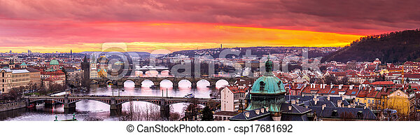 Bridges in Prague over the river at sunset - csp17681692