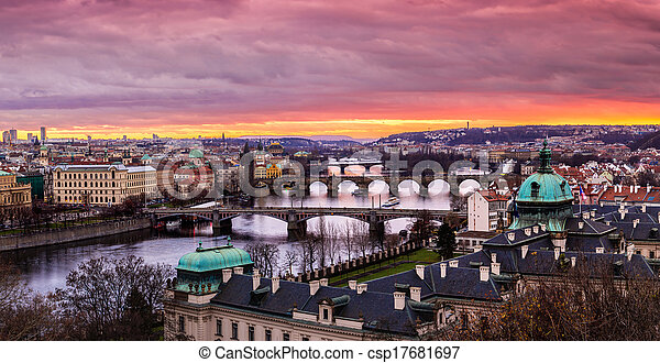 Bridges in Prague over the river at sunset - csp17681697