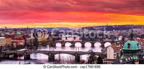 Bridges in Prague over the river at sunset - csp17681698