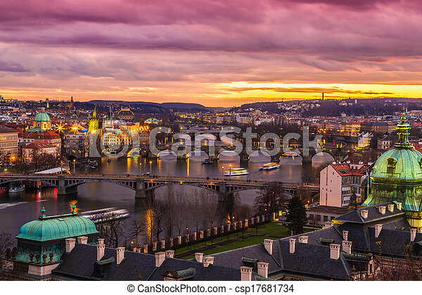Bridges in Prague over the river at sunset - csp17681734