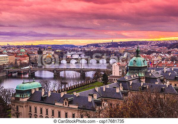 Bridges in Prague over the river at sunset - csp17681735