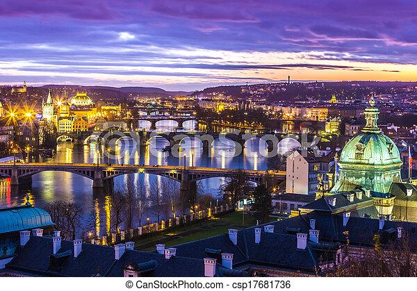 Bridges in Prague over the river at sunset - csp17681736