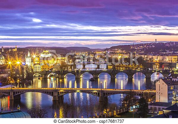 Bridges in Prague over the river at sunset - csp17681737